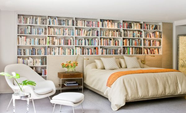 Surprising-Bedroom-Design-for-Book-Lovers-with-Huge-Floor-to-Ceiling-Bookcase-Headboard-Design-and-Lazy-Chair-with-Footboard